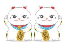 Japonés gemelo Lucky Cat; Maneki Neko Foto de archivo