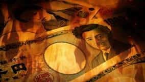 Japonés Yen Banknotes Rotating In Fire almacen de metraje de vídeo
