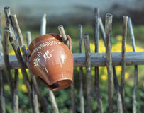 Jar. Crock on wood fence, Zuberec, Slovakia stock images