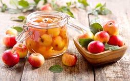 Jar of apple jam with fresh fruits Stock Photo