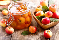 Jar of apple jam with fresh fruits Stock Photography