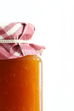 Jar of apricot jam Royalty Free Stock Images