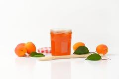 Jar of apricot jam Stock Photography