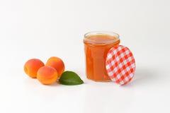 Jar of apricot jam Royalty Free Stock Image
