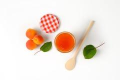 Jar of apricot jam Stock Photos