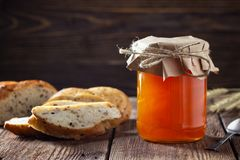 Jar with apricot jam stock photo