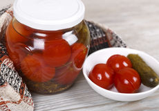 Jar of assorted pickled tomatoes and cucumbers Stock Photos