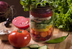 Jar with autumn vegetables ready to be pickled. Jar with autumn vegetables on cutting board ready to be pickled Stock Image