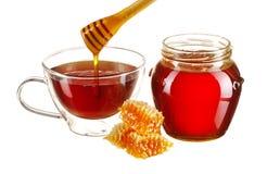 Jar av honung och teakoppen fotografering för bildbyråer
