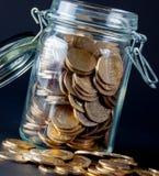 Jar av mynt Arkivbild