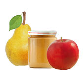 Jar of baby puree, apple and fresh yellow pear with green leaf i Royalty Free Stock Images