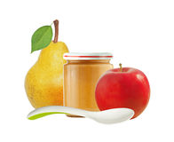 Jar of baby puree, apple and fresh yellow pear with green leaf i Stock Photos