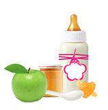 Jar of baby puree, baby milk bottle, apple and dummy isolated  Royalty Free Stock Photos