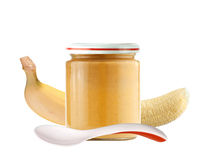Jar of baby puree and banana isolated on white Stock Photos