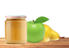 Jar of baby puree, green apple and pear on wooden table  Royalty Free Stock Photo