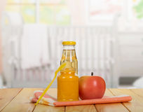Jar  baby puree, juice bottle, apple, spoon on  background  kitchen. Royalty Free Stock Image