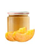 Jar of baby puree and peach slice isolated on white Stock Image