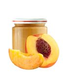 Jar of baby puree and peach slice isolated on white Royalty Free Stock Photo
