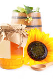 Jar and barrel with honey and flowers Stock Images