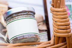 Jar in a basket Stock Photos