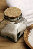 Jar of Bath Salts. And towels on bamboo Royalty Free Stock Photography