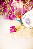 Jar of bath sea salt and violet flowers Stock Photo