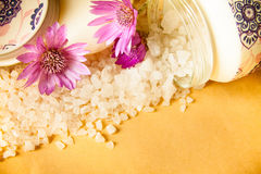 Jar of bath sea salt and violet flowers Royalty Free Stock Image