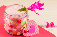 Jar of bathing salt. Glass jar with colorful butterfly stickers filled with bathing salt Stock Photos