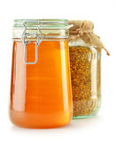 Jar with bee pollen and jar with honey isolated Stock Images