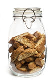 Jar of Biscotti. A jar of biscotti on white background stock photos