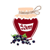 Jar of black currant jam Royalty Free Stock Image