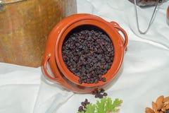 Jar with black sun raisings on a table. Stock Photo