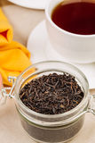 Jar with black tea inside Royalty Free Stock Photography