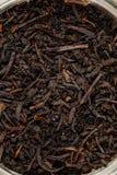 Jar with black tea inside Stock Photography