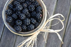 Jar of Blackberries / wooden background Royalty Free Stock Photo