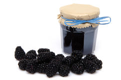 Jar of blackberry jam with fresh blackberries Royalty Free Stock Image