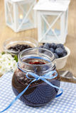 Jar of blueberry jam decorated with blue bow Royalty Free Stock Images