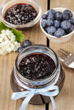 Jar of blueberry jam decorated with blue bow Royalty Free Stock Image