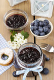 Jar of blueberry jam decorated with blue bow Royalty Free Stock Photo