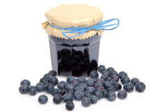 Jar of blueberry jam with fresh blueberries Royalty Free Stock Images
