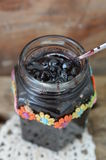 Jar of blueberry jam stock photography