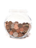 Jar of British currency coins Stock Photos