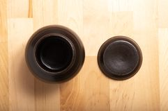 Jar on the wood table. Jar on the brown wood table stock image