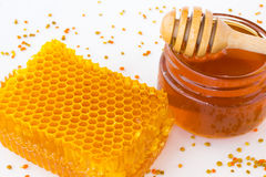Jar with buckwheat honey and the honeycomb Royalty Free Stock Photography