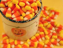Jar of candy corn stock photo
