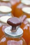 Jar cap tool. Manual cap tool on apple juice jar Royalty Free Stock Image