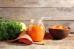Jar of carrot juice. On wooden table stock images