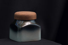 Jar for cereals. On black cloth background Royalty Free Stock Photography