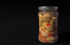 Jar of champignon mushrooms Royalty Free Stock Photography