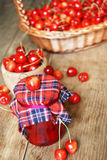 Jar with cherries on the wooden table Stock Photos